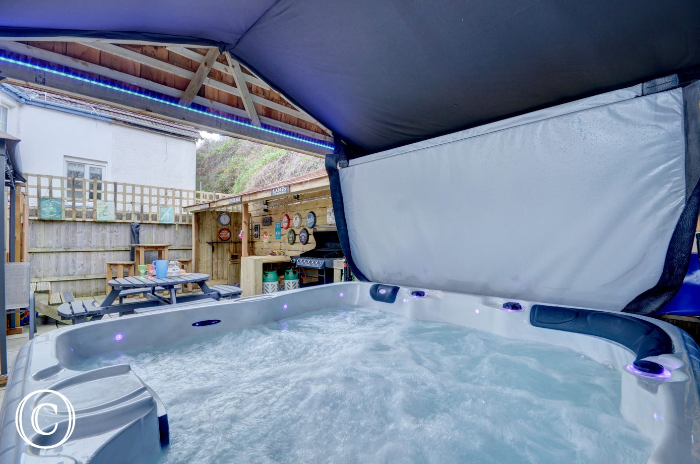 Jump into the hot tub after a day on the beach