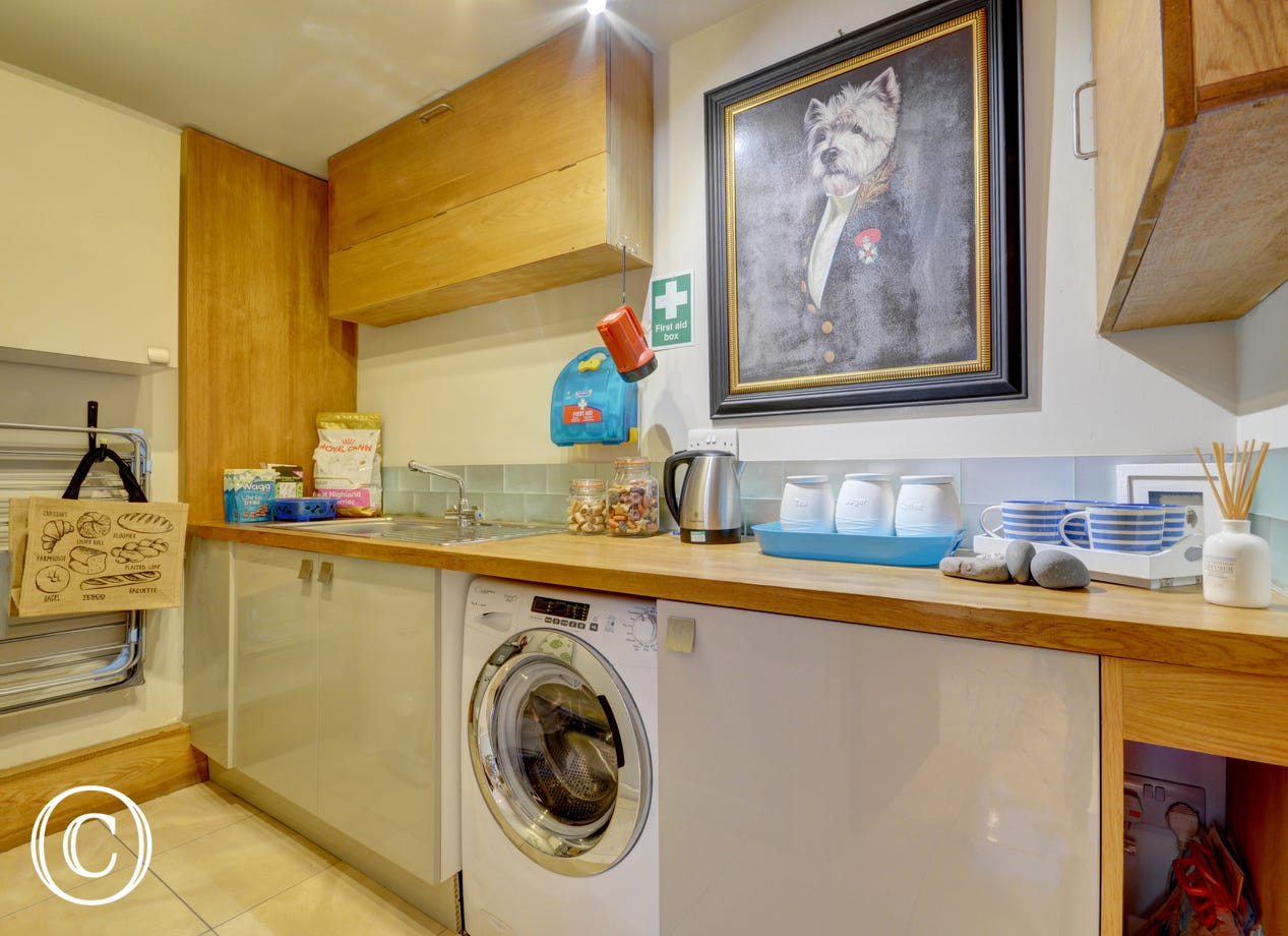 Useful utility room with sink, extra fridge and kettle