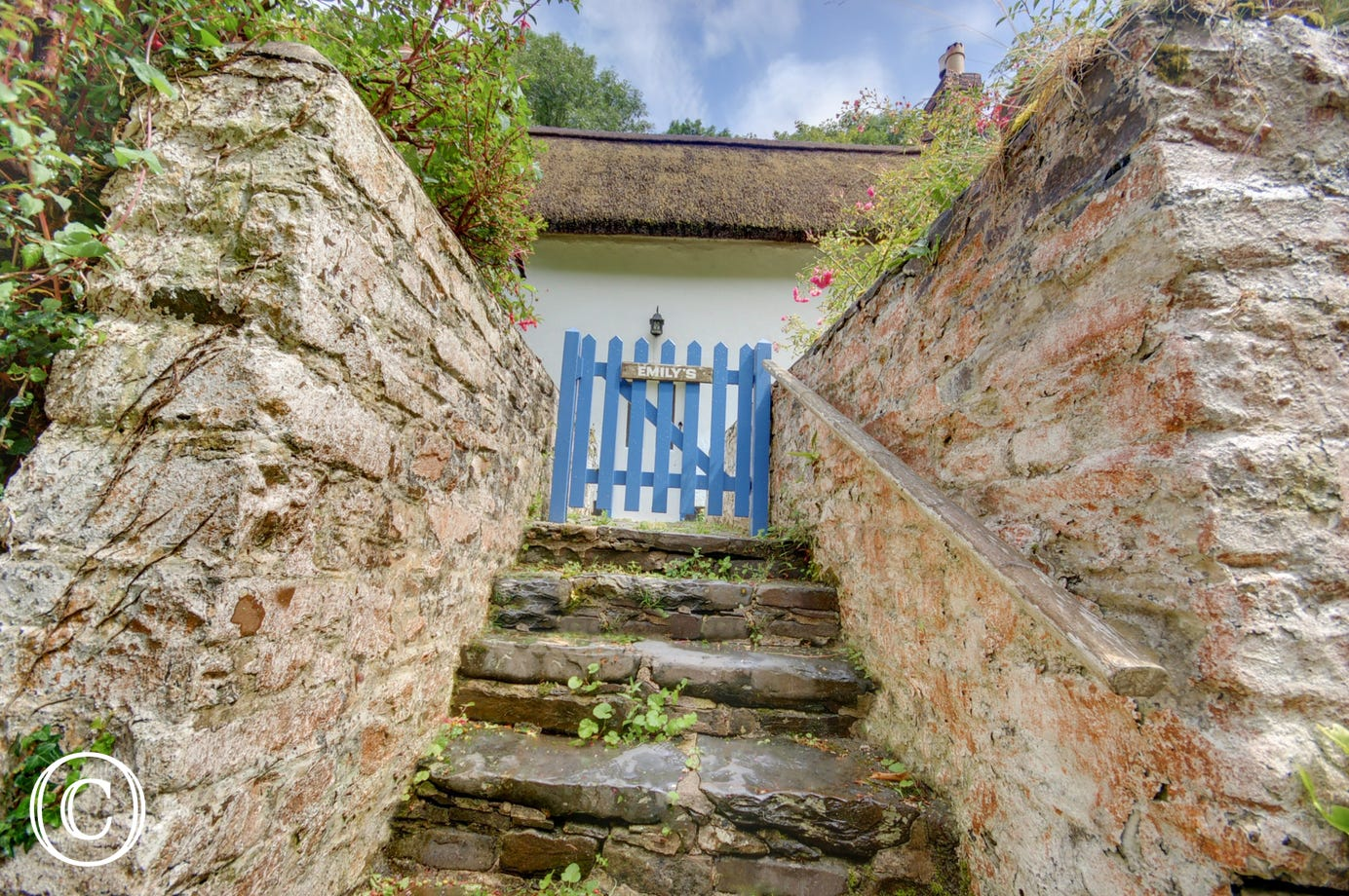 Steps up to the front of the cottage