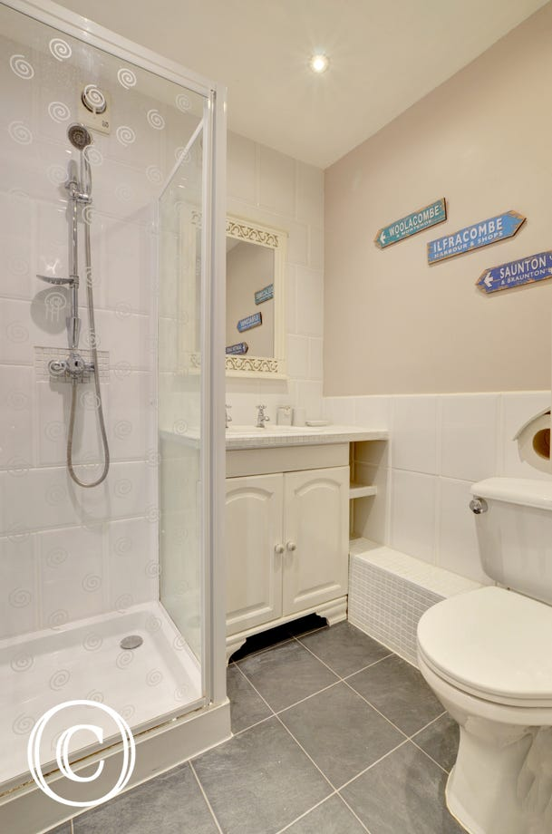 Ensuite bathroom with shower, basin and WC