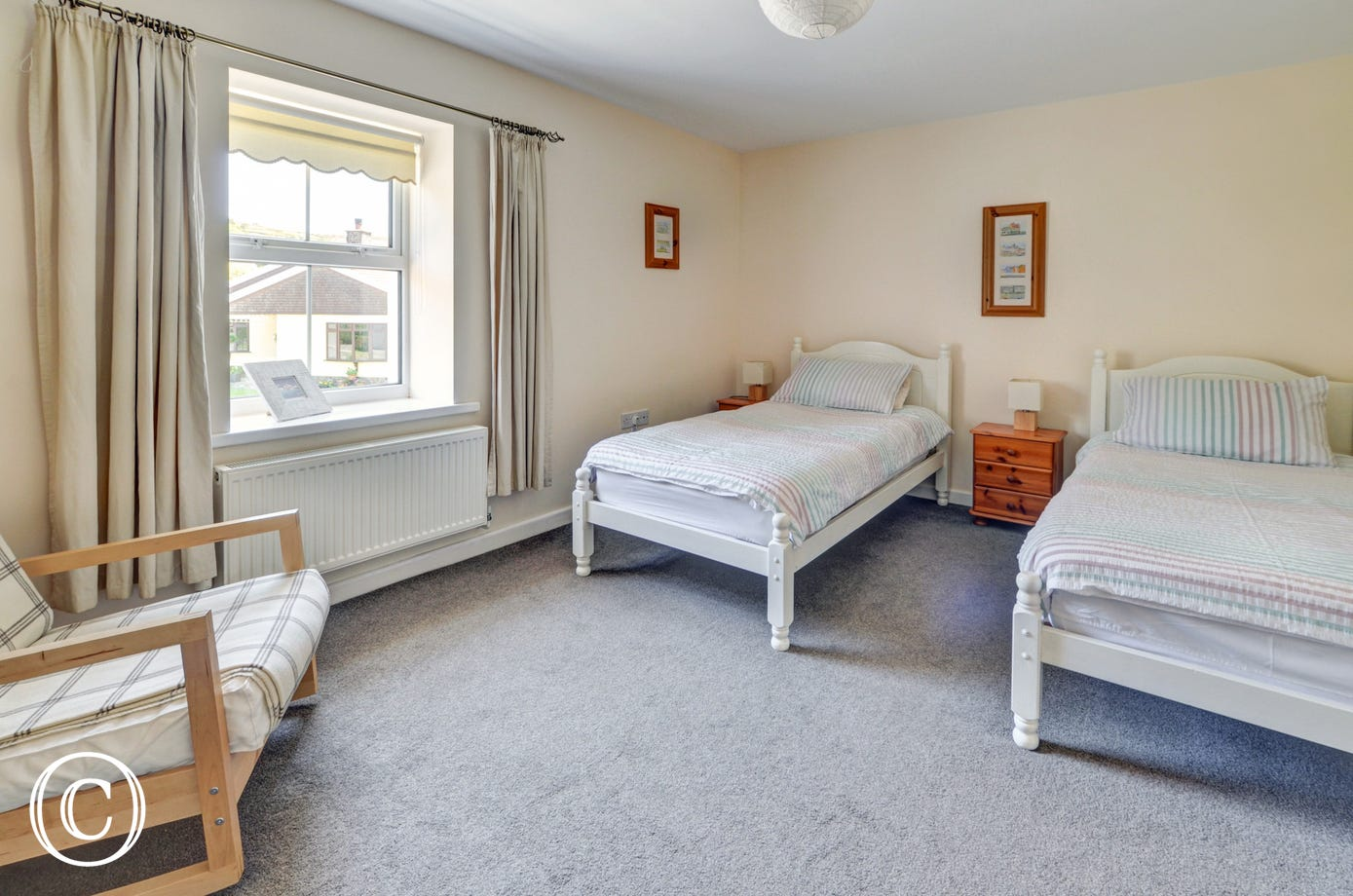The twin bedroom is spacious and bright