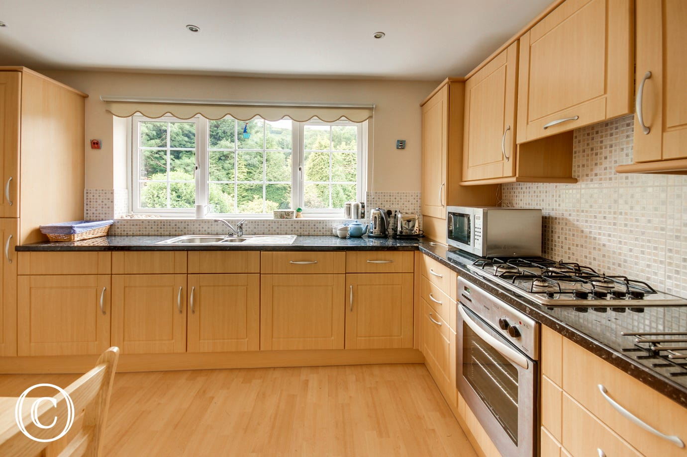The well equipped kitchen is very spacious with plenty of cupboard space for all your provisions