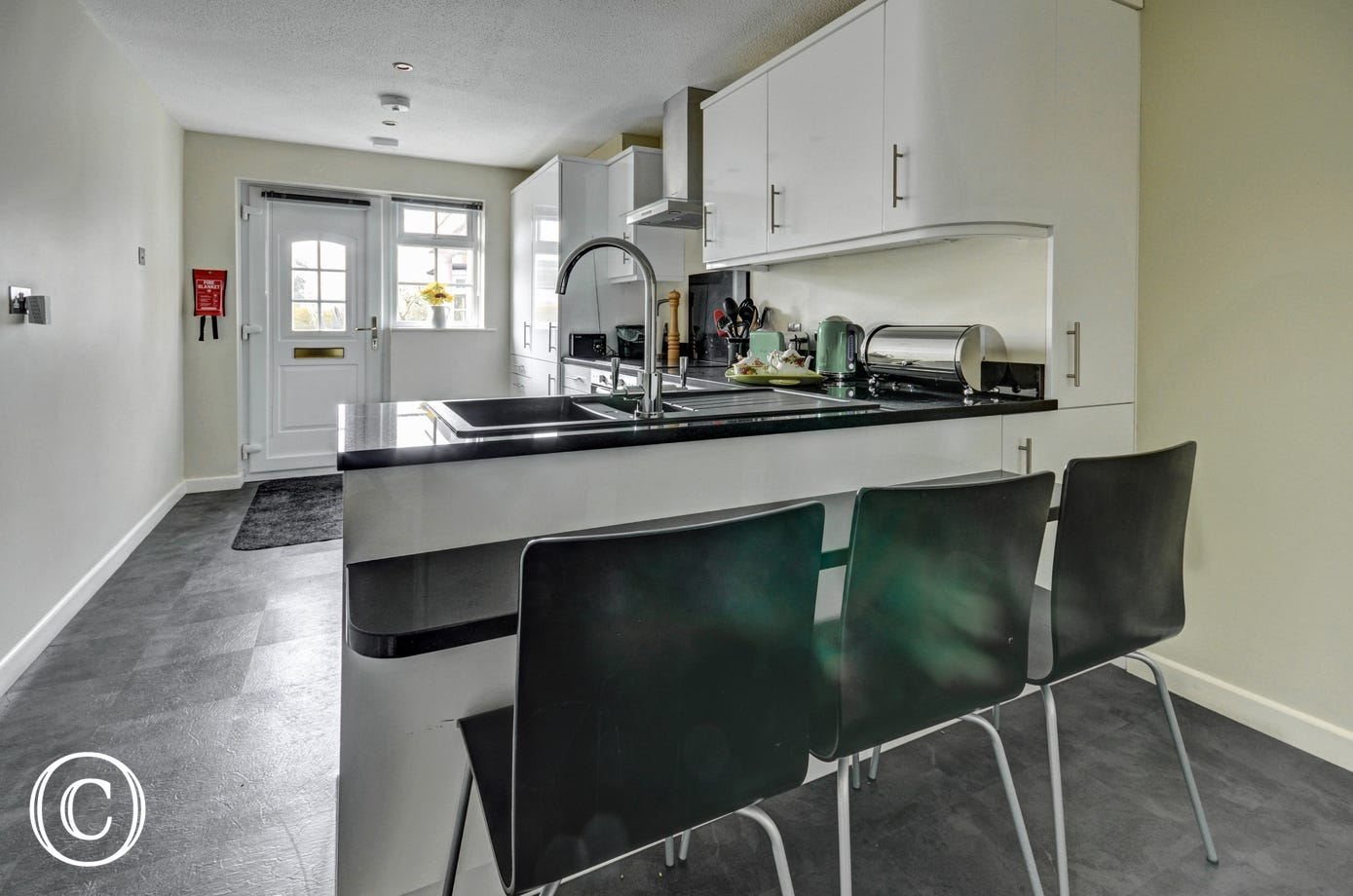 The excellent well equipped kitchen has everything you will need including a breakfast bar
