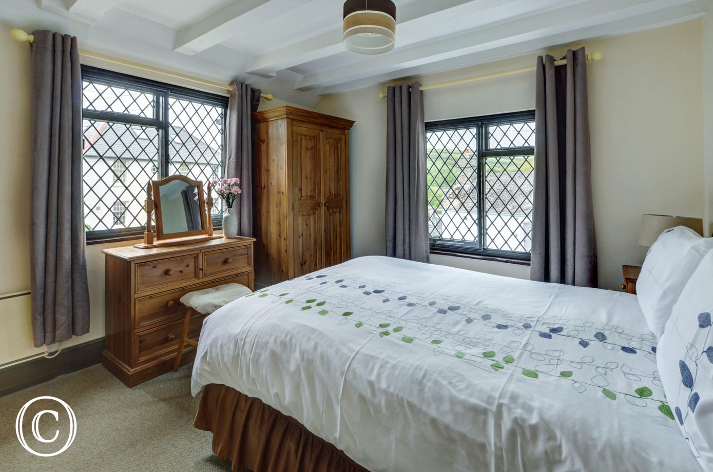 The master bedroom with double bed and ensuite bathroom