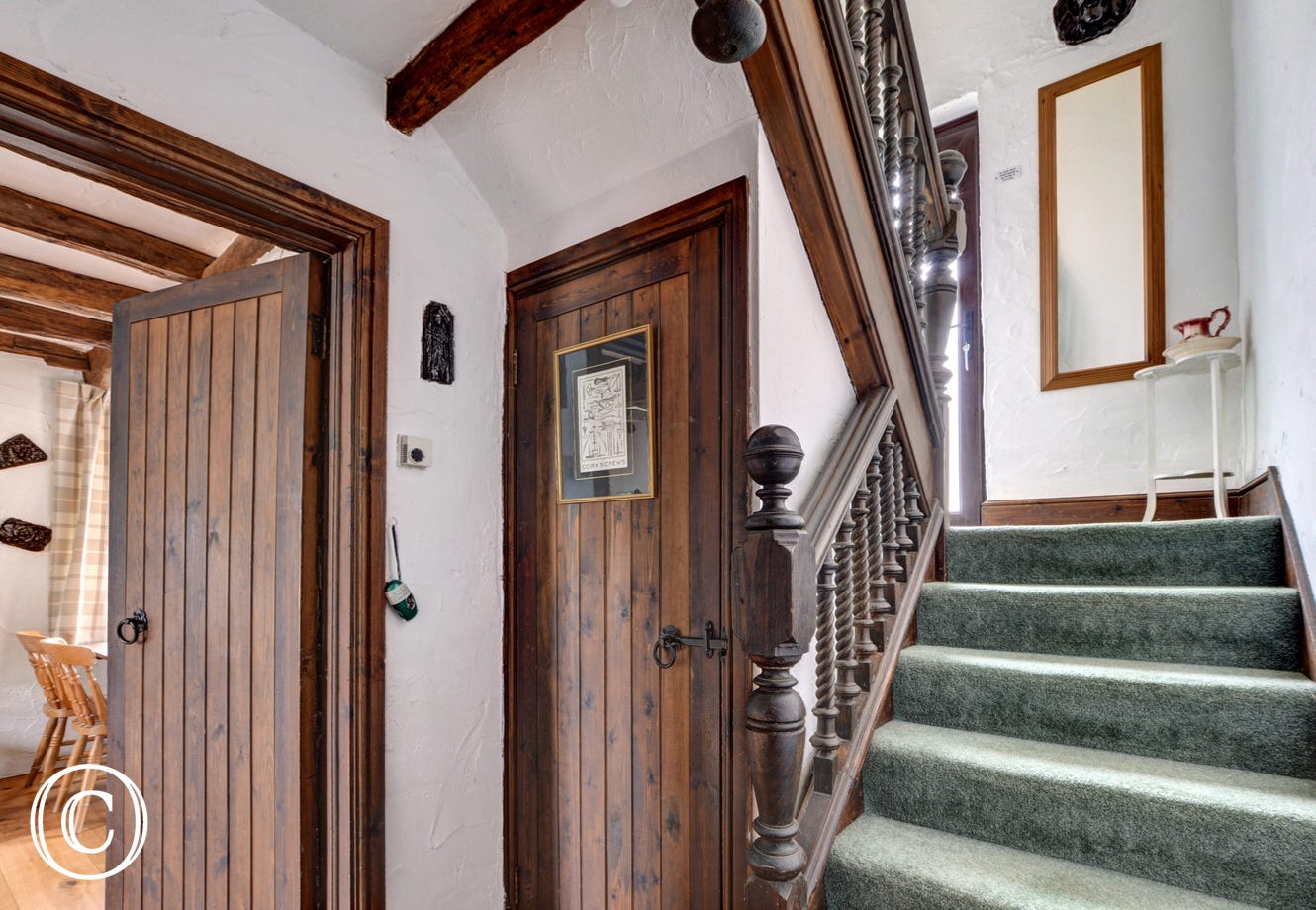 The hallway and stairs up to the patio door