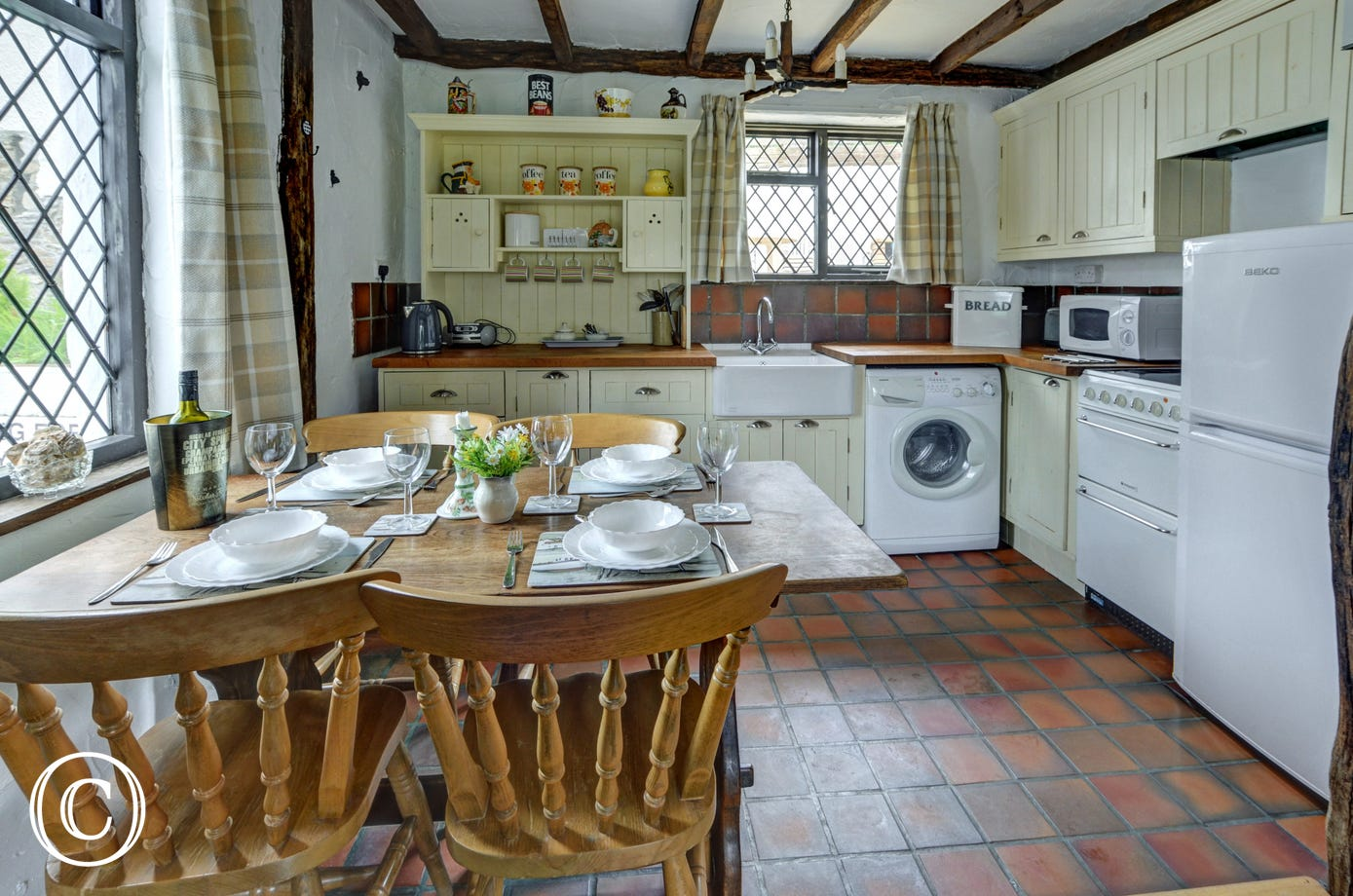 The kitchen is well equipped and has a dining table with space for four people
