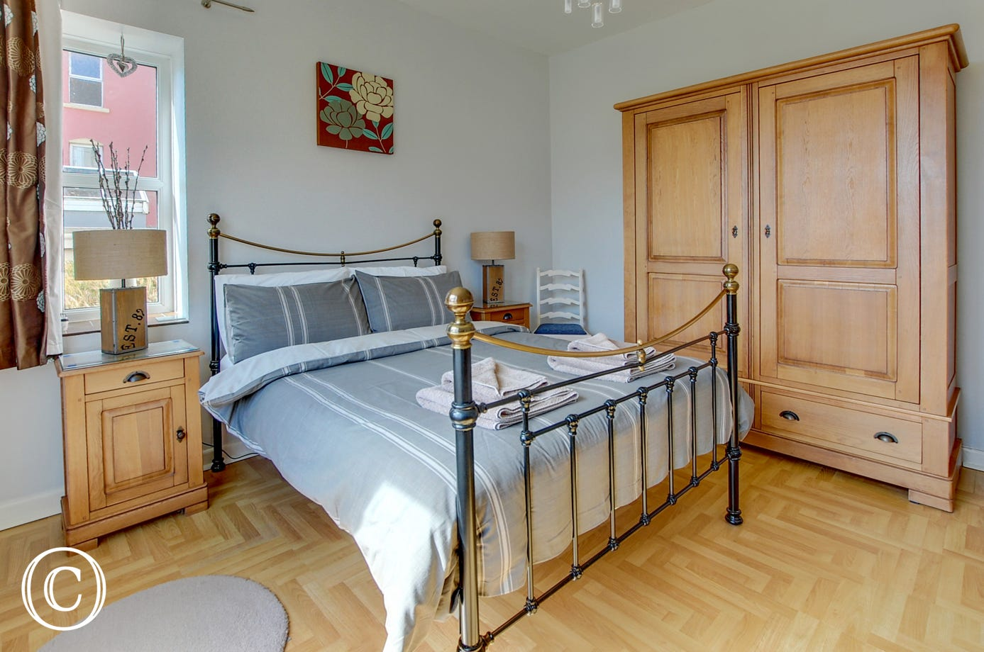 Master bedroom with double bed and ample wardrobe space