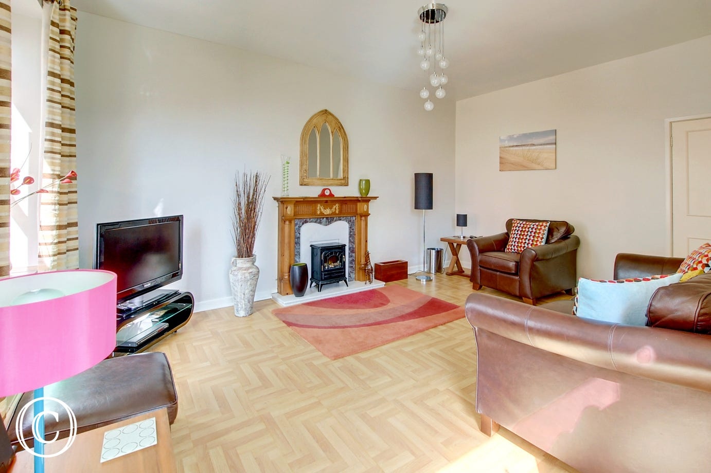 Deceptively spacious and stylishly presented sitting room