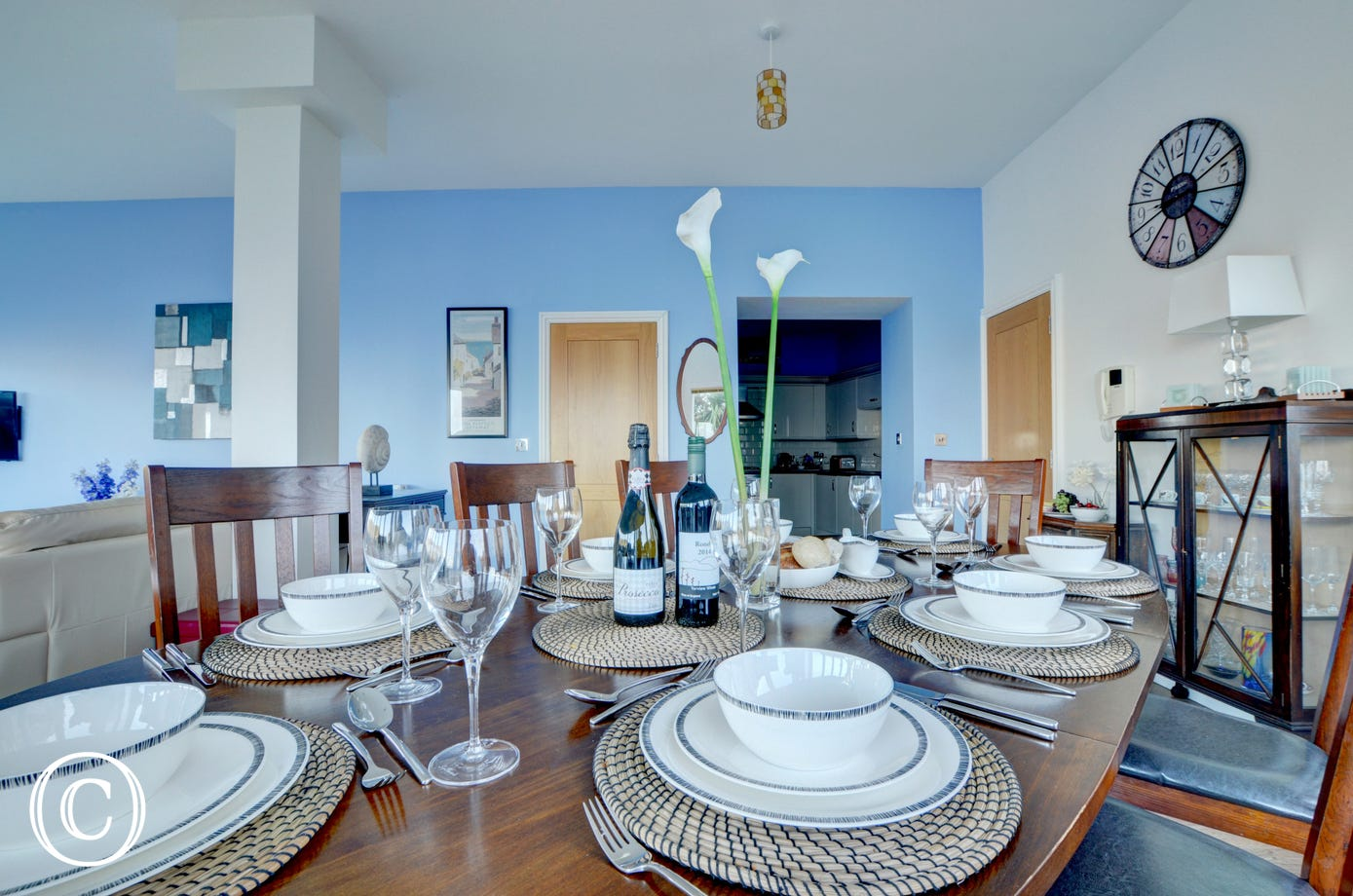 Enjoy fine dining around the large dining table which comfortably seats 8 people