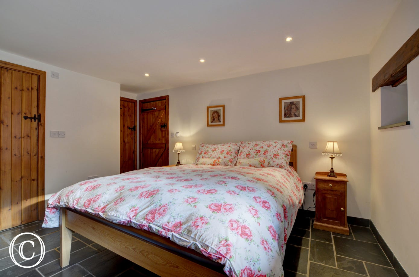 Master bedroom with kingsize bed and ensuite bathroom