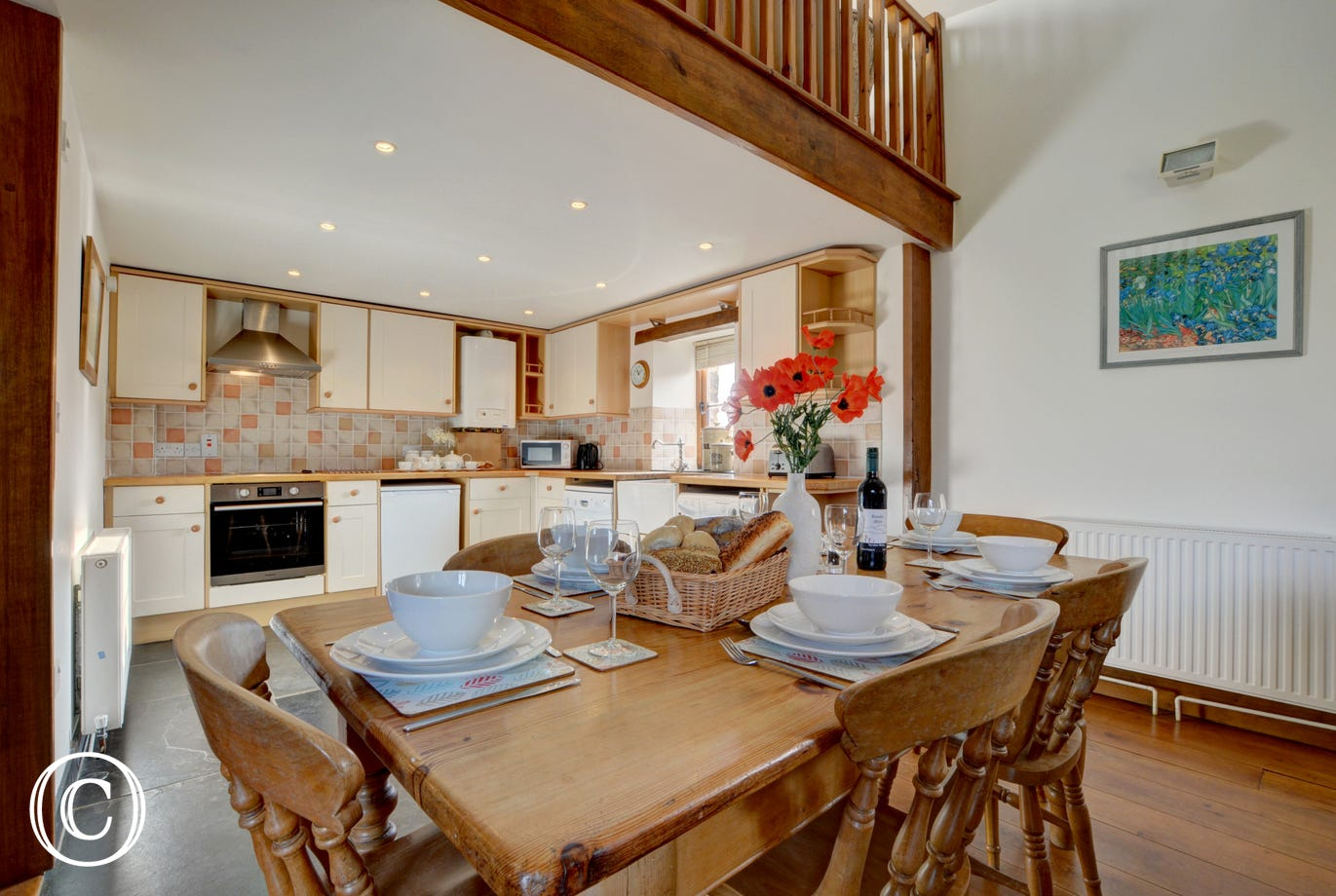 A large kitchen and dining area has all you will need should you decide to dine in