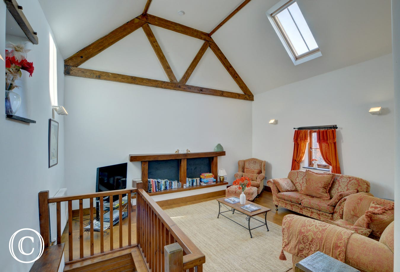 Spacious comfortable sitting room with vaulted beamed ceiling