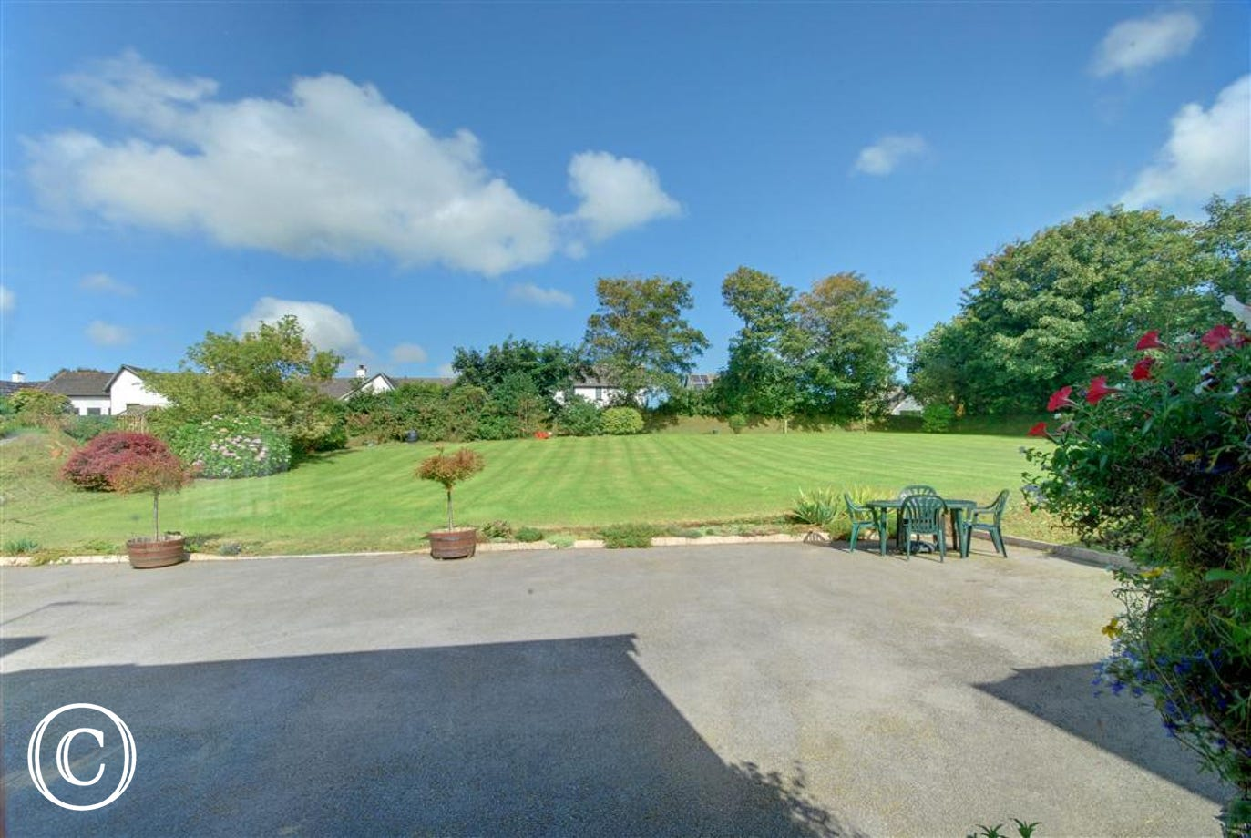 Large south facing lawn ideal for childrens play.