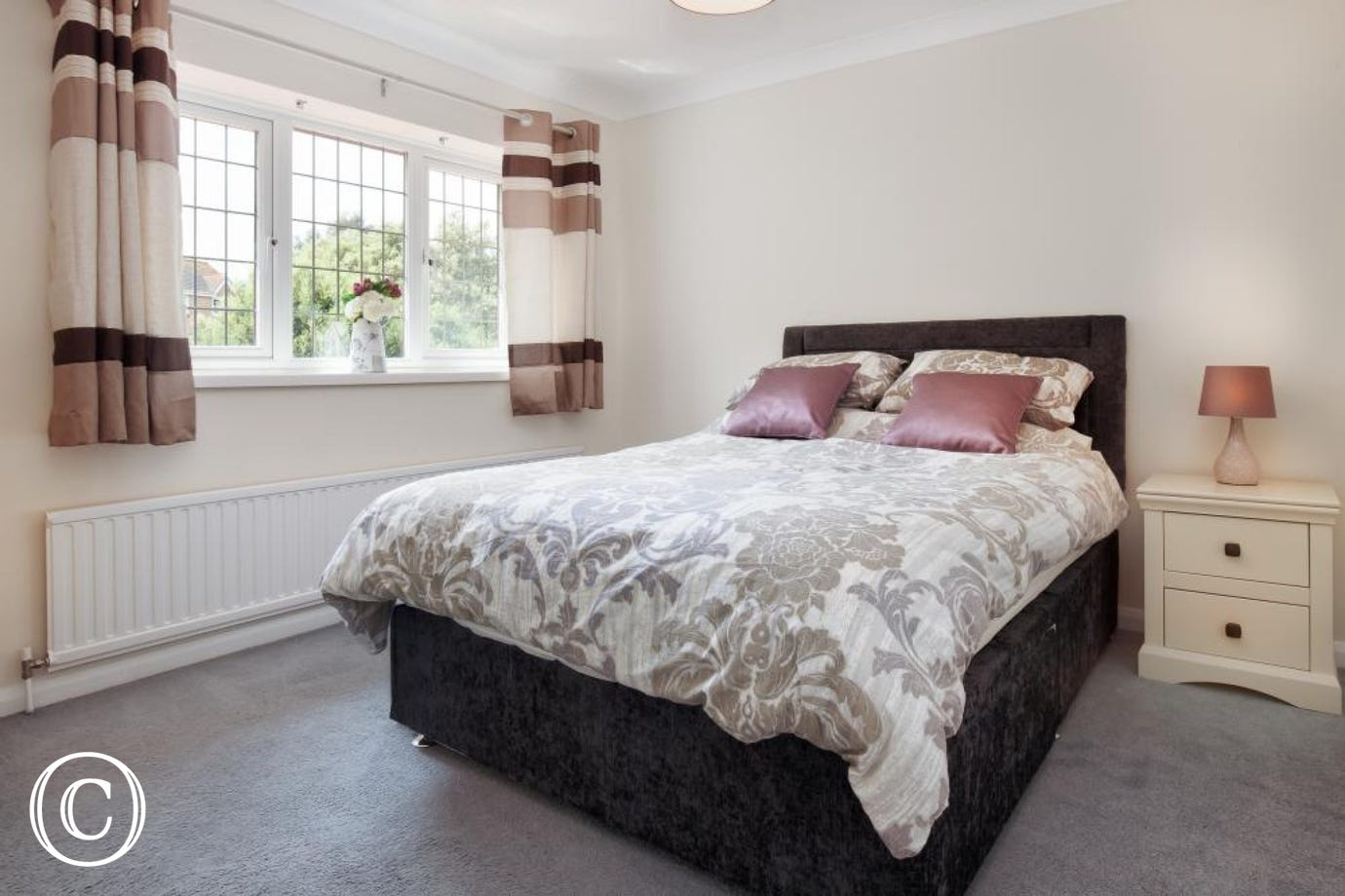 A Comfortable Chic Kingsize Room with Wardrobes, Dressing Table & TV.