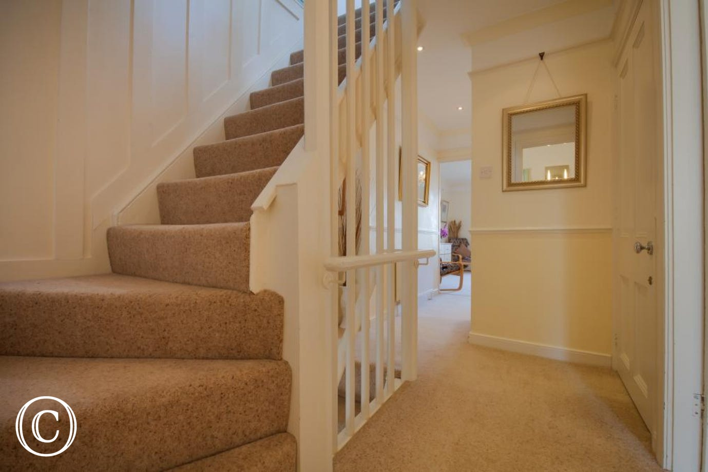 First floor landing & stairs leading up to the top floor and two further bedrooms