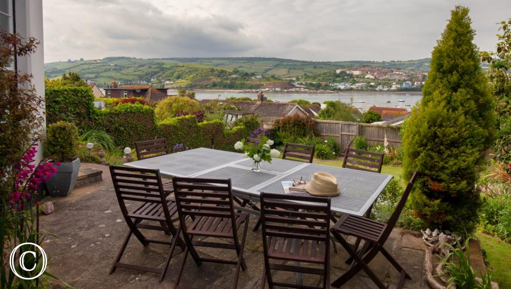 Large table & chairs on the terrace, in a sheltered terrace spot with gorgeous views.