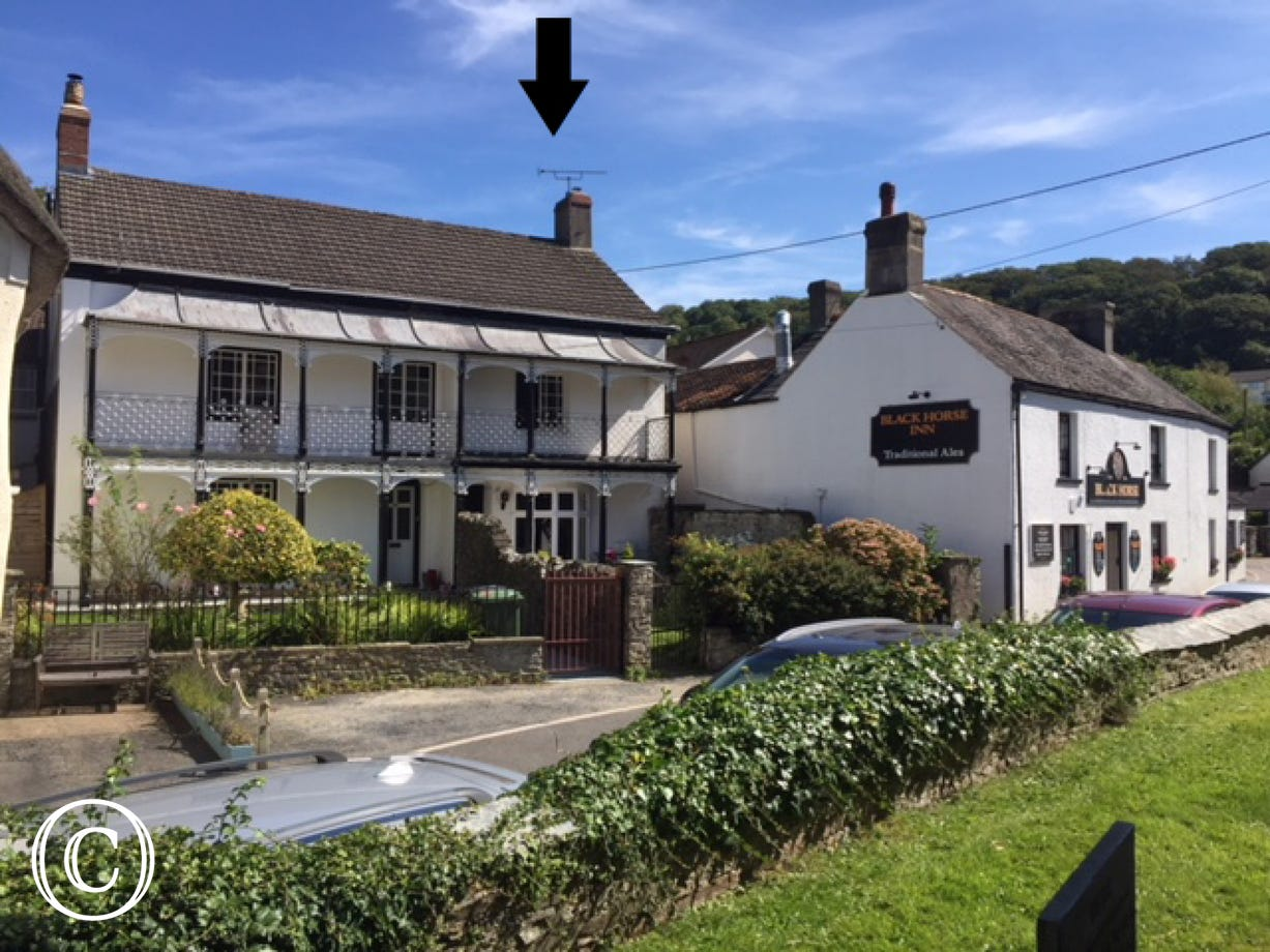 Gladstone is an attractive Grade II colonial style character house located in the historic part of Braunton, opposite the picturesque Parish Church and next to one of the local village pubs
