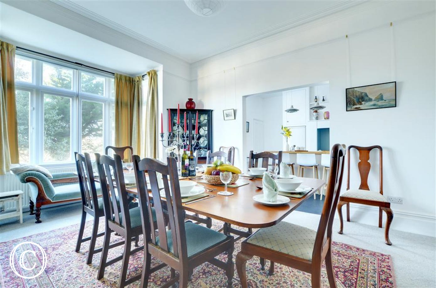 A fabulous space to entertain friends and family in this elegant dining room with kitchen adjacent