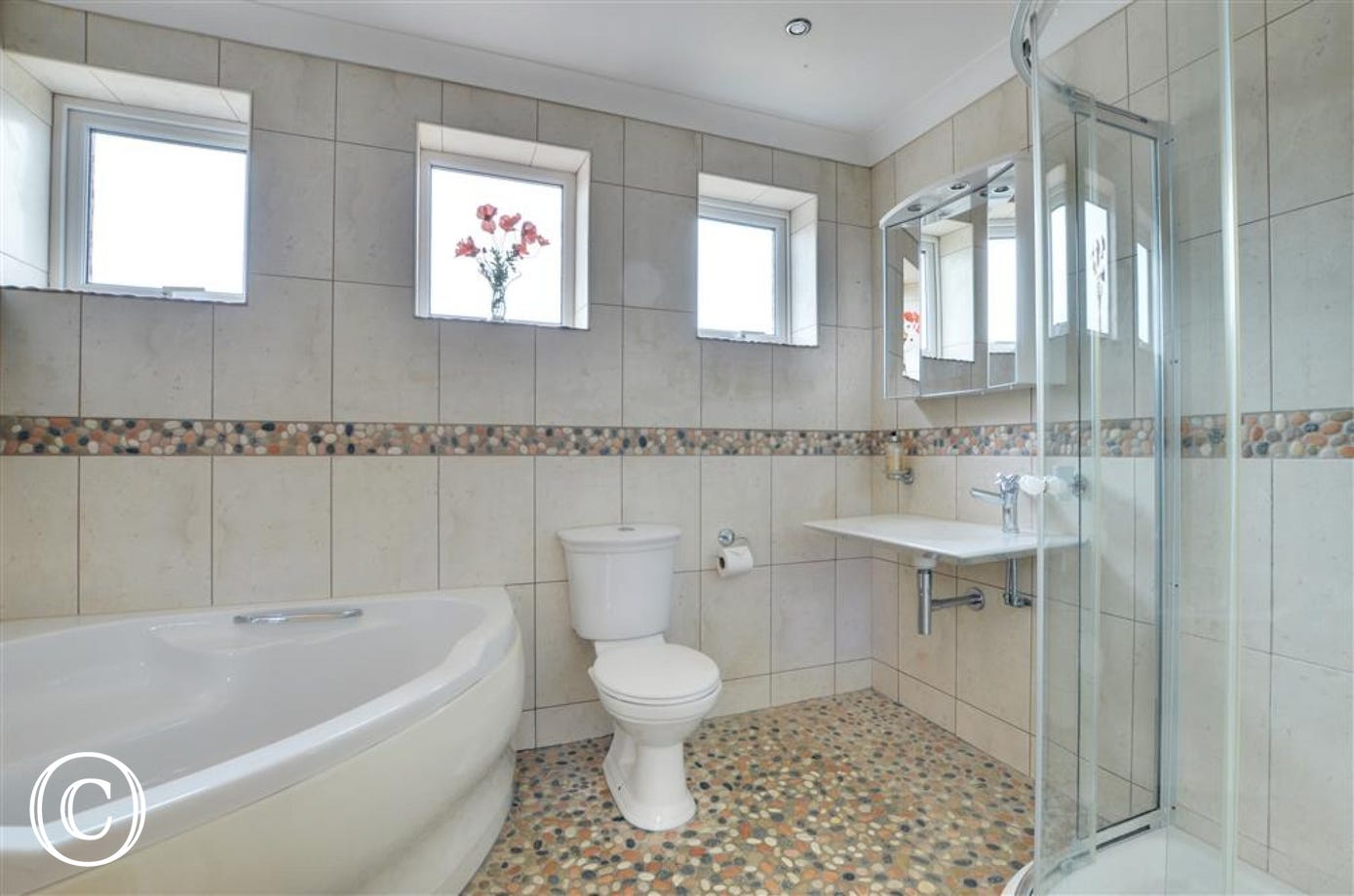 Generous sized family bathroom with modern white suite and shower