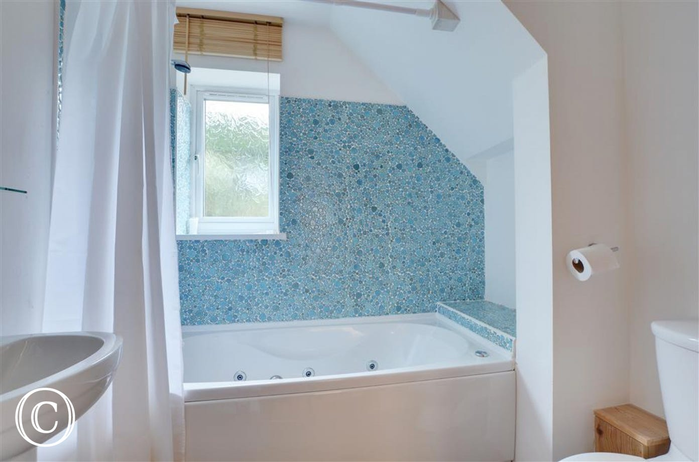 Ensuite bathroom with fabulous Jacuzzi style bath on the lower ground floor