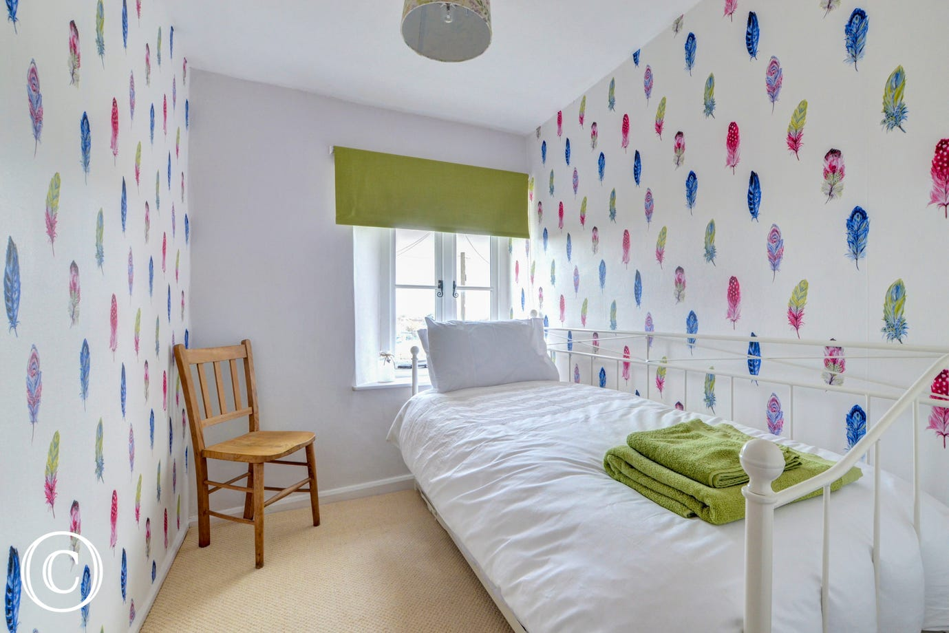 The cosy single bedroom has been brightly decorated