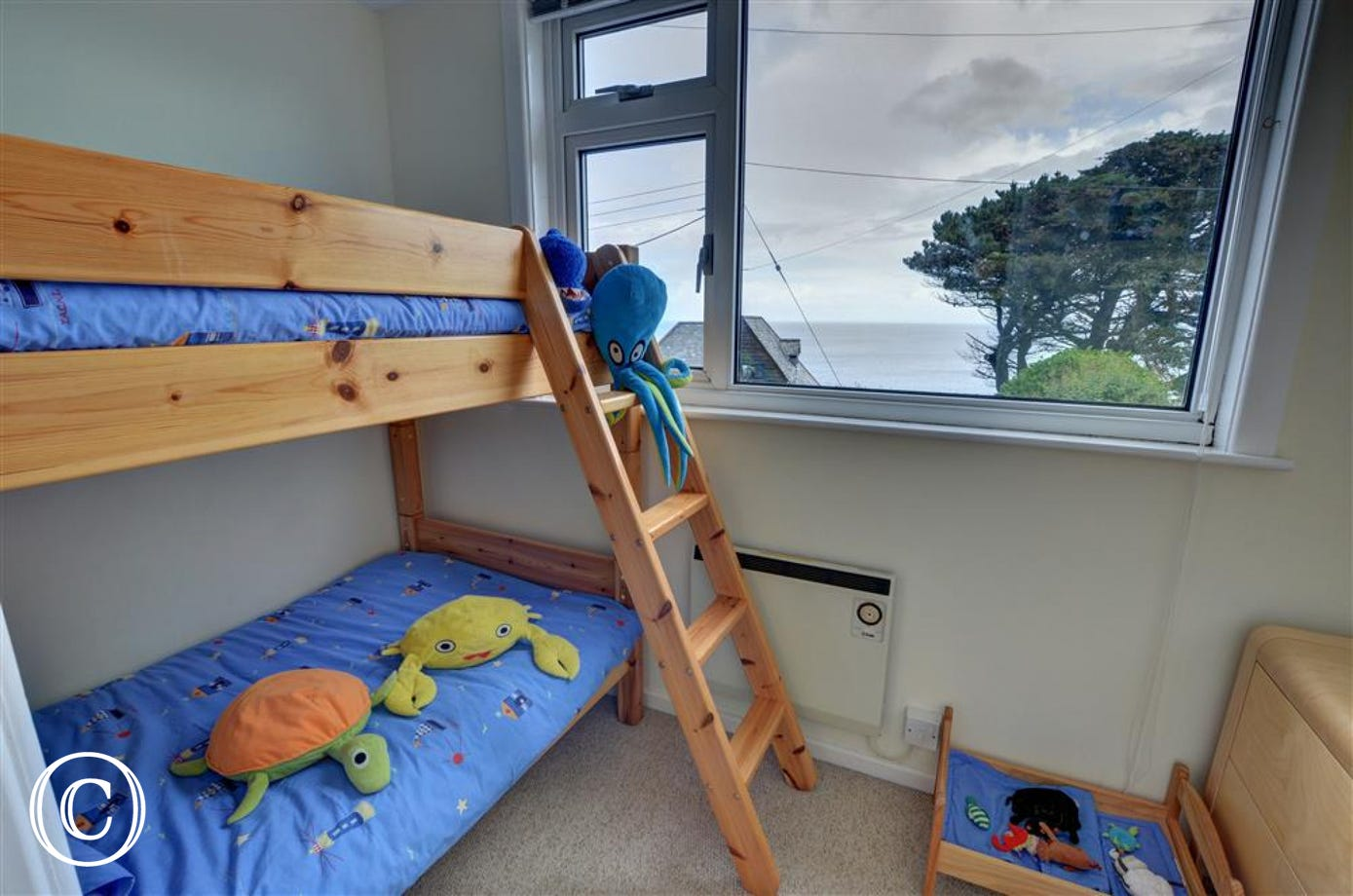 Bedroom 6 with short bunk beds suitable for children.