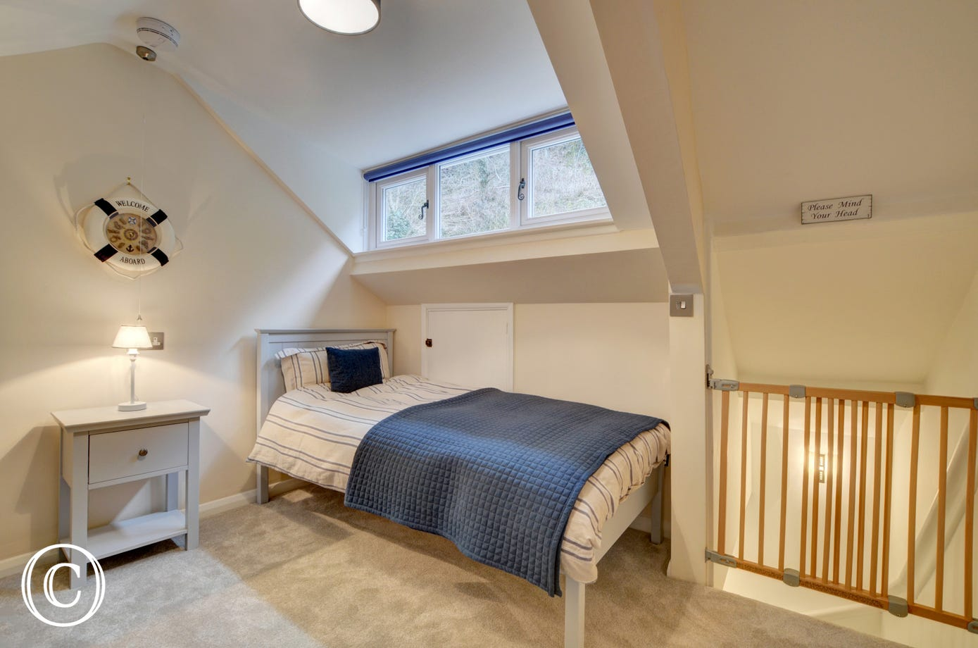 Further steep stairs to the second floor opens out into a second attractive bedroom with sloping ceiling and twin beds