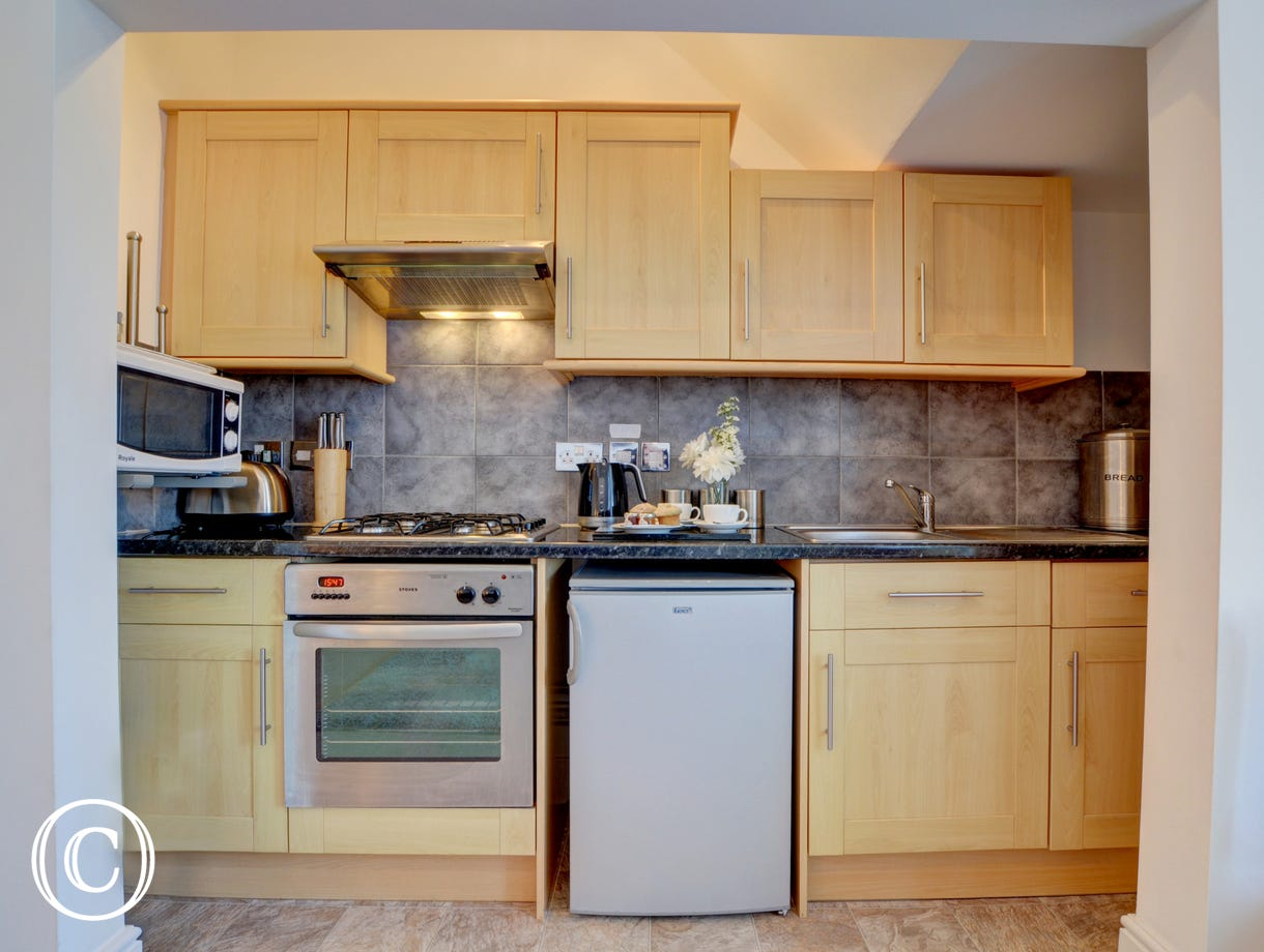 The compact kitchen is well equipped for your stay