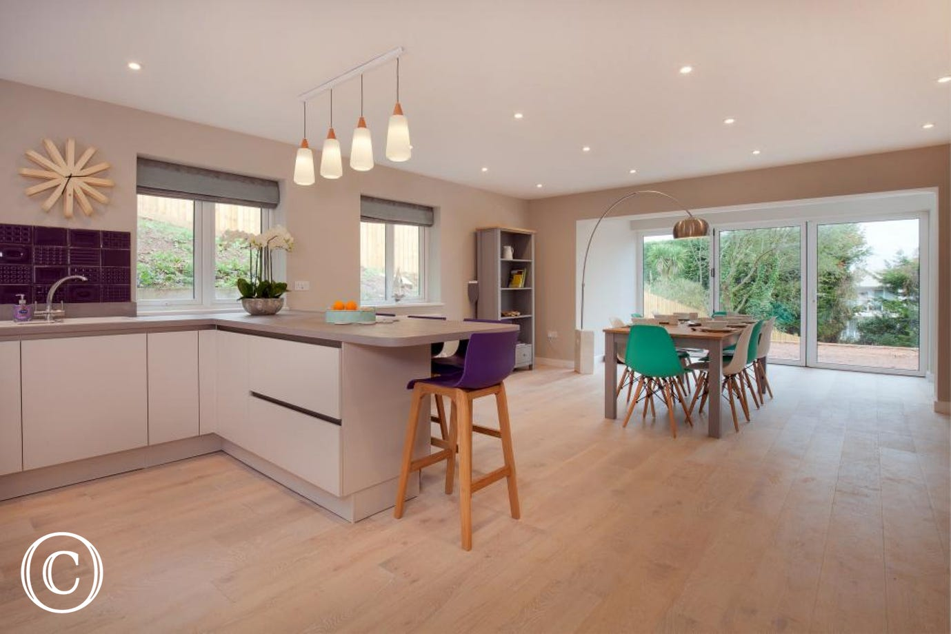 Extremely spacious kitchen & dining room with views over the large sunny terrace & gardens below
