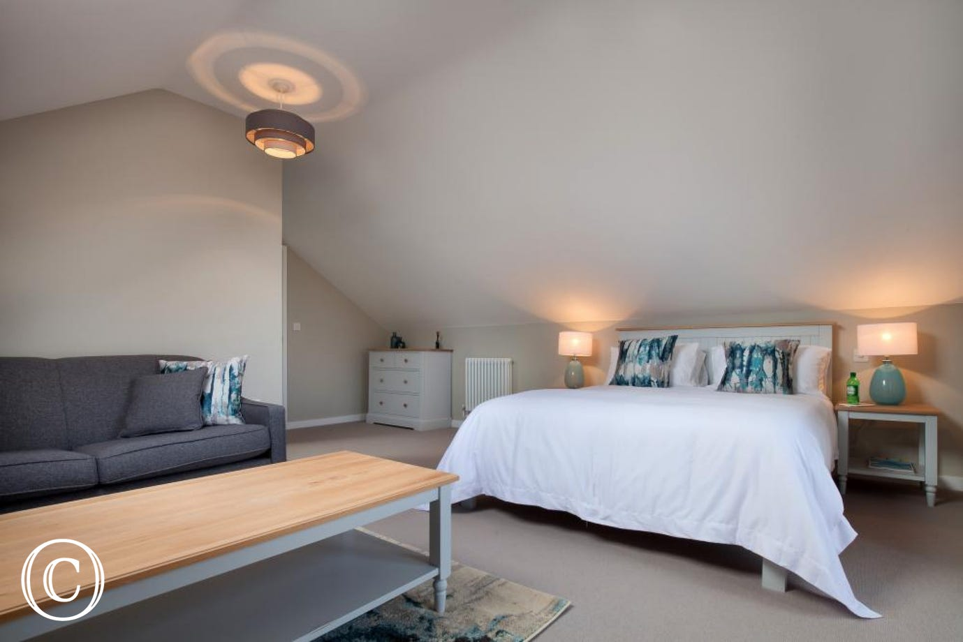 Upstairs master king-size bedroom with en-suite shower room, TV, sofa bed & glass doors opening out onto a sunny balcony