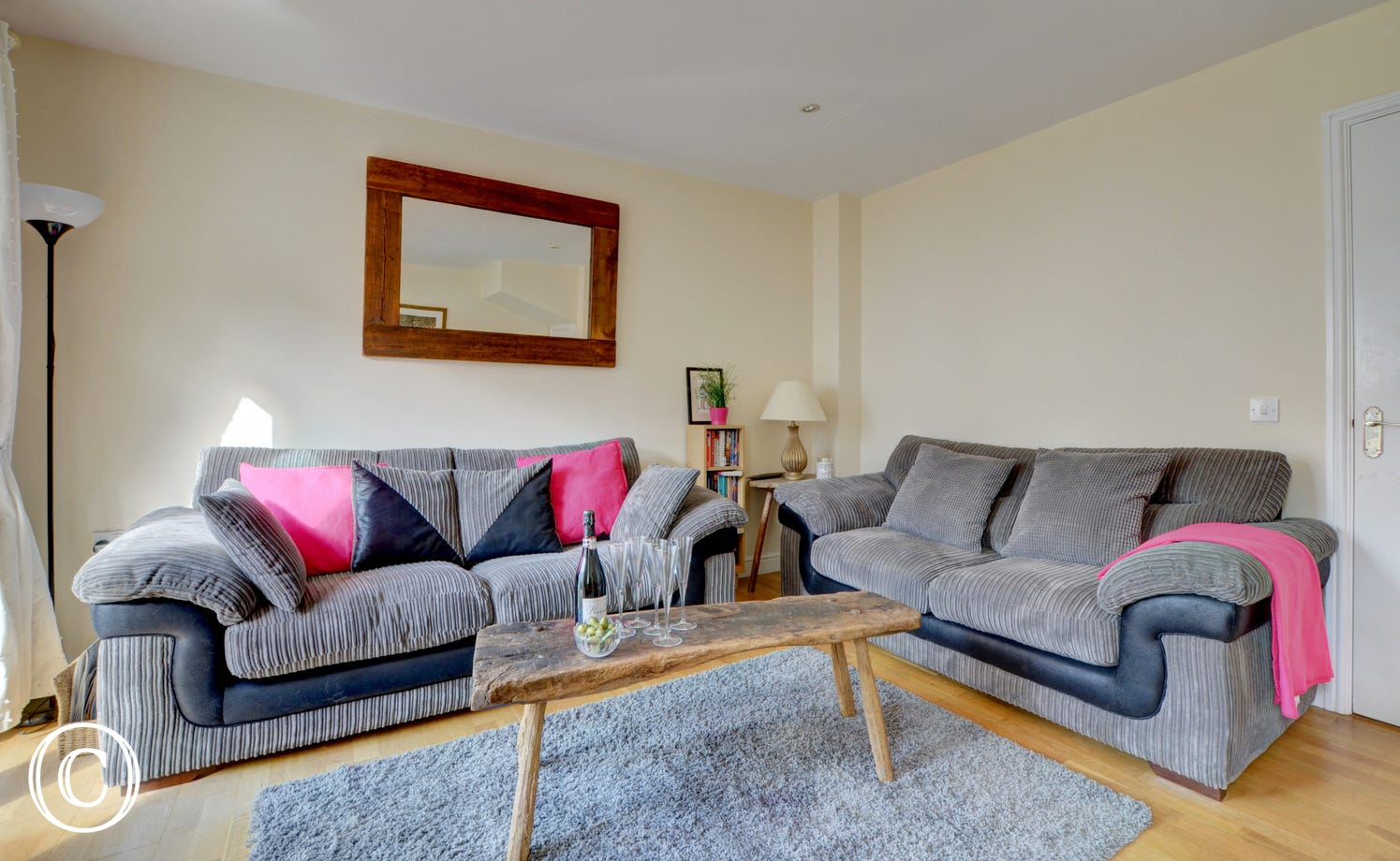 Comfortable sofas in the sitting room which look out over the patio