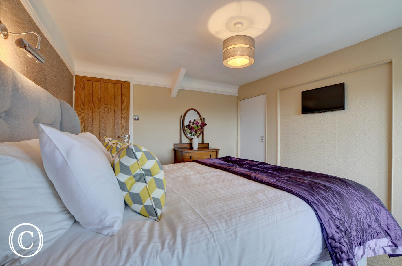 The smaller double bedroom has a TV, plenty of wardrobe space and wonderful views