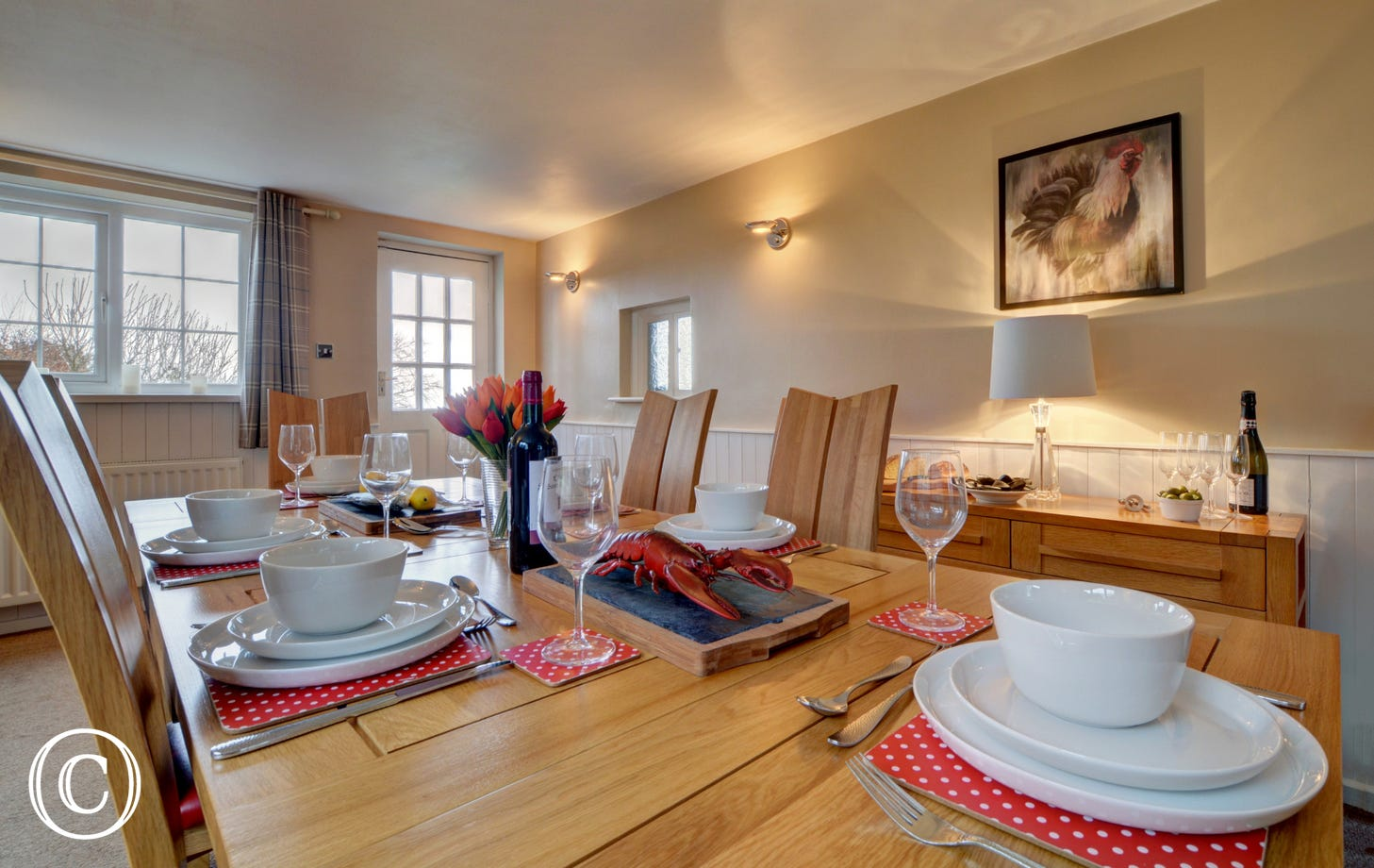 The spacious and stylish dining room is a wonderful space to get together with family and friends and is adjacent to a very well equipped kitchen