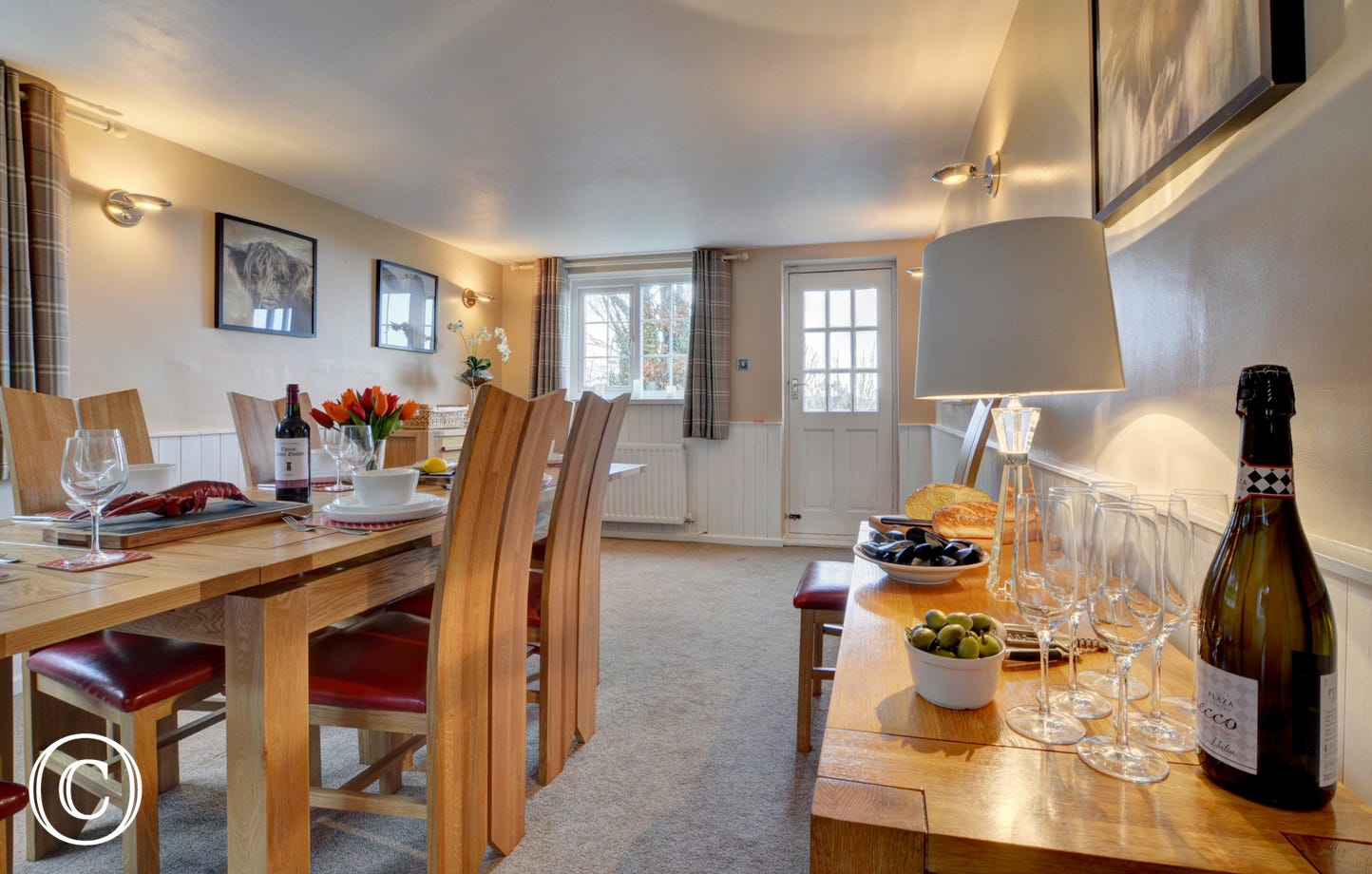 The spacious and stylish dining room is a wonderful space to get together with family and friends