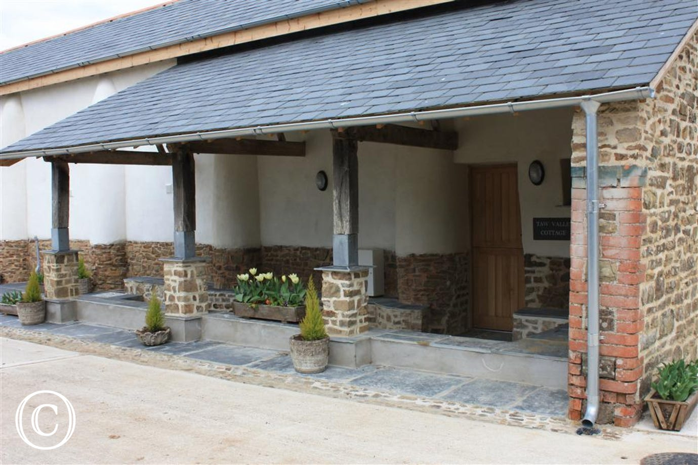 Parking and entrance to Taw Valley Cottage