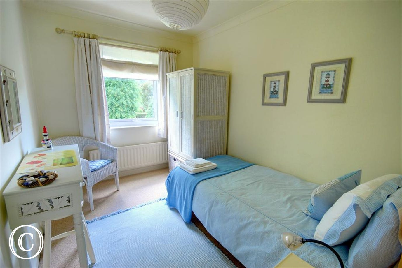 Attractive single bedroom with a nautical feel, ideal for the children