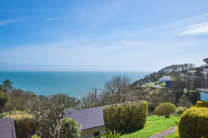 Gardens of the property with spectacular views over Start Bay