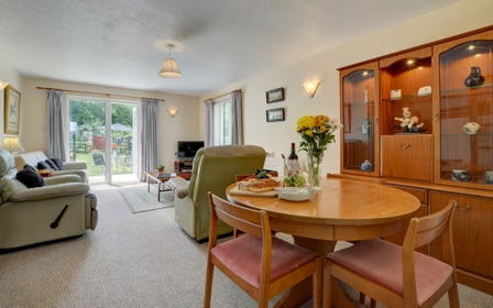 The bright dining and sitting room is a lovely space to socialise