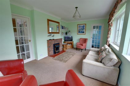 The sitting room benefits from an electric fire making it cosy and comfortable on cooler evenings.