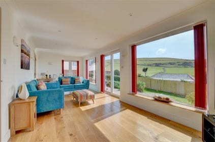 Large picture windows make the most of the bay views in the sitting room