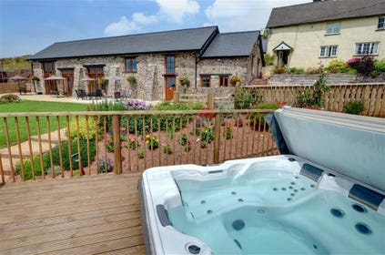 Relax and unwind in the shared hot tub at the end of a busy day exploring