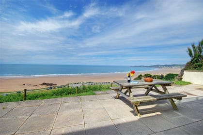 Enjoy al fresco dining after a fun day at the beach on this wonderful terrace
