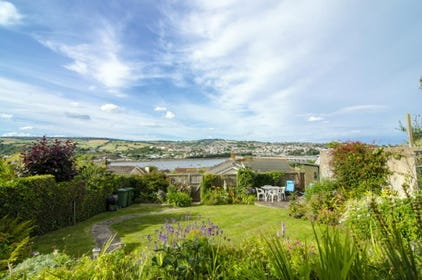Beautifully kept garden bathed in sunshine with glorious river views