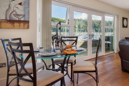 A dining table & four chairs is available for guests to use with stunning views across the River.