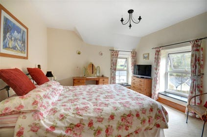Wake up to delightful countryside views from the spacious bedroom on the first floor