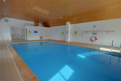 Indoor heated swimming pool with kiddies corner.