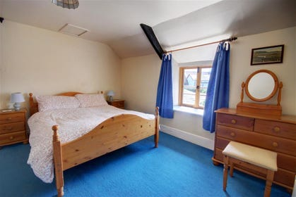 This spacious double bedroom has estuary views.