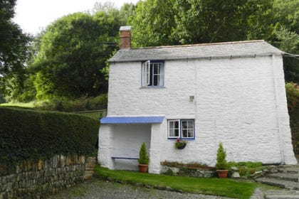 In a picturesque coastal setting Garden Cottage is one of two romantic cottages at Saltdene, Combe Martin