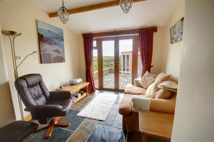 The cottage is warmed by underfloor heating and tastefully decorated with high quality furnishings throughout