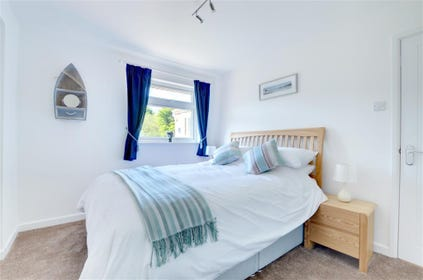 The king bedroom also has a small sun room with garden furniture which looks out onto the rear garden